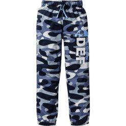 Spodnie dresowe bonprix szary wzorzysty. Szare dresy chłopięce bonprix, z nadrukiem, z dresówki. Za 44,99 zł.
