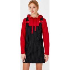 Sukienki hiszpanki: Sukienka na szelkach z kółkami