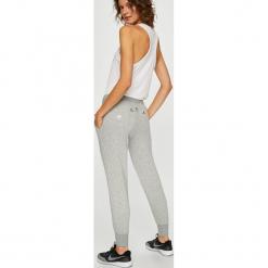 Nike Sportswear - Spodnie. Szare bryczesy damskie Nike Sportswear, l, z bawełny. W wyprzedaży za 229,90 zł.