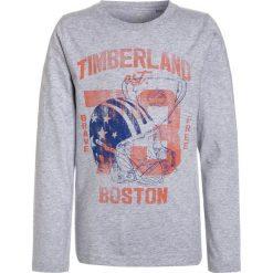 Timberland BOSTON Bluzka z długim rękawem meliertes grau. Czerwone bluzki dziewczęce bawełniane marki Timberland. W wyprzedaży za 126,65 zł.