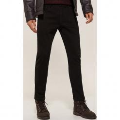 Ocieplane spodnie slim fit - Czarny. Czarne rurki męskie marki House. Za 139,99 zł.