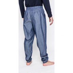 Emporio Armani - Spodnie piżamowe. Szare piżamy męskie marki Emporio Armani, l, z nadrukiem, z bawełny, z okrągłym kołnierzem. W wyprzedaży za 359,90 zł.