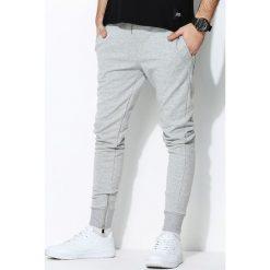 Szare Spodnie Dresowe Sufficient. Czarne spodnie dresowe męskie marki Born2be, l, z aplikacjami, z dresówki. Za 104,99 zł.