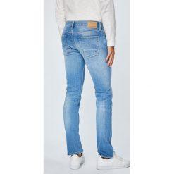 Tommy Hilfiger - Jeansy Denton. Niebieskie jeansy męskie z dziurami TOMMY HILFIGER. Za 539,90 zł.