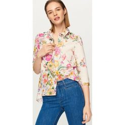 Koszula w kwiaty - Wielobarwn. Białe koszule damskie marki Reserved, l, z dzianiny. W wyprzedaży za 49,99 zł.