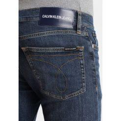 Calvin Klein Jeans 026 SLIM Jeansy Slim Fit antwerp mid. Czarne jeansy męskie relaxed fit marki Calvin Klein Jeans, z bawełny. Za 419,00 zł.