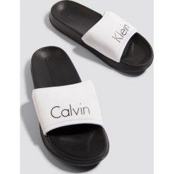 Calvin Klein Klapki - Black,White,Multicolor. Białe chodaki damskie Calvin Klein, w paski, z gumy. Za 161,95 zł.