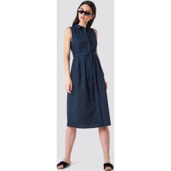 MANGO Sukienka koszulowa z paskiem - Navy. Niebieskie sukienki na komunię marki Mango, w paski, z koszulowym kołnierzykiem, bez rękawów, midi, koszulowe. Za 161,95 zł.