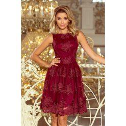 DORLIN Ekskluzywna rozkloszowana sukienka z haftem - BORDOWA. Czerwone sukienki hiszpanki numoco, l, z haftami, rozkloszowane. Za 339,98 zł.