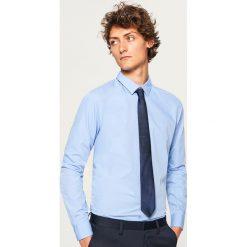 Koszula regular fit - Niebieski. Niebieskie koszule męskie marki Reserved, m. W wyprzedaży za 49,99 zł.