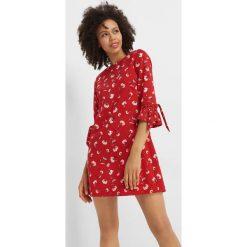 Sukienka mini w kwiaty. Czerwone sukienki dzianinowe Orsay, na lato, s, w kwiaty, mini, rozkloszowane. Za 119,99 zł.