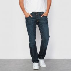Jeansy Tim krój slim, denim ze stretchem. Czarne jeansy męskie slim marki Jack & Jones, l, z bawełny, z okrągłym kołnierzem. Za 356,96 zł.