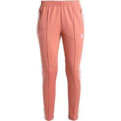 Spodnie dresowe damskie: adidas Originals ADICOLOR Spodnie treningowe ash pink