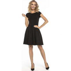 Czarna Kobieca Sukienka  z Dołem w Zakładki. Sukienki małe czarne marki KALENJI, z elastanu, z krótkim rękawem, krótkie. Za 128,90 zł.