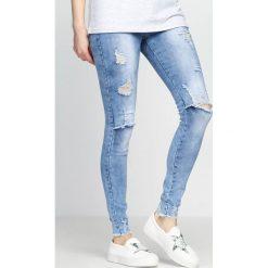 Niebieskie Jeansy Devastation. Czarne jeansy damskie z dziurami marki Born2be, l. Za 44,99 zł.