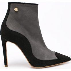 Love Moschino - Botki. Czarne buty zimowe damskie marki Love Moschino, z materiału, na obcasie. W wyprzedaży za 799,90 zł.