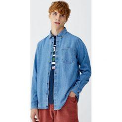 Koszula jeansowa basic. Niebieskie koszule męskie jeansowe marki Pull&Bear, m, z długim rękawem. Za 79,90 zł.