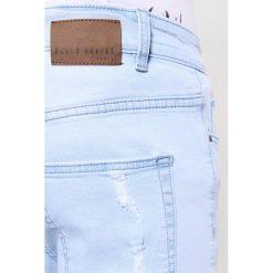 Black Kaviar KOOP Jeansy Slim Fit light blue. Niebieskie jeansy męskie relaxed fit Black Kaviar. W wyprzedaży za 319,20 zł.