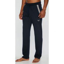 Emporio Armani - Spodnie piżamowe. Szare piżamy męskie marki Emporio Armani, l, z nadrukiem, z bawełny, z okrągłym kołnierzem. W wyprzedaży za 319,90 zł.