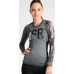 Reebok Koszulka sportowa iron steel. Szare topy sportowe damskie marki Reebok, m, z elastanu. W wyprzedaży za 143,20 zł.