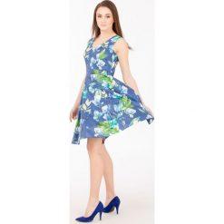 Sukienki hiszpanki: Sukienka w kolorowe kwiaty