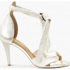 Sandały złote Gulietta. Żółte sandały damskie marki Kazar, ze skóry, na wysokim obcasie, na obcasie. Za 175,99 zł.