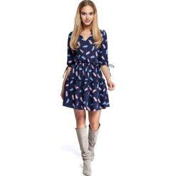 CAROLINE Sukienka boho z nadrukiem - model 3. Niebieskie sukienki boho marki numoco, na imprezę, s, w kwiaty, z jeansu, sportowe. Za 199,00 zł.