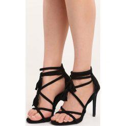 Czarne Sandały Wiren. Czarne sandały damskie marki Born2be, z materiału, na wysokim obcasie, na obcasie. Za 69,99 zł.
