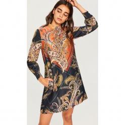 Sukienka w orientalny wzór - Bordowy. Czerwone sukienki marki Reserved. Za 139,99 zł.