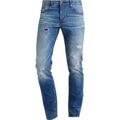 GStar 3301 SLIM Jeansy Slim fit medium indigo aged. Niebieskie jeansy męskie relaxed fit marki G-Star. W wyprzedaży za 439,20 zł.