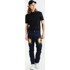GStar PHARRELL WILLIAMS ELWOOD X52 3D Jeansy Straight Leg sartho blue. Szare jeansy męskie marki G-Star. W wyprzedaży za 417,45 zł.