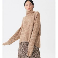 Sweter oversize - Brązowy. Czarne swetry oversize damskie marki KIPSTA, z poliesteru, do piłki nożnej. Za 99,99 zł.