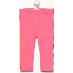 Spodnie niemowlęce: Spodnie dresowej z pomponami – Różowy