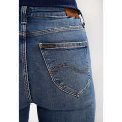 Lee SCARLETT HIGH Jeans Skinny Fit destroyed denim. Szare jeansy damskie marki Lee, z bawełny. W wyprzedaży za 209,40 zł.