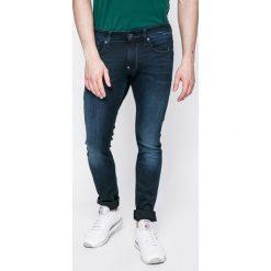G-Star Raw - Jeansy Revend. Niebieskie jeansy męskie slim marki G-Star RAW. W wyprzedaży za 279,90 zł.