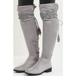 Szare Kozaki Gig Out. Szare buty zimowe damskie marki Born2be, na płaskiej podeszwie. Za 99,99 zł.