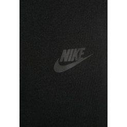 Nike Performance Spodnie treningowe black. Czarne spodnie chłopięce Nike Performance, z bawełny. W wyprzedaży za 209,30 zł.