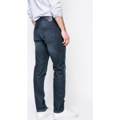 U.S. Polo - Jeansy. Niebieskie jeansy męskie slim marki U.S. Polo, z bawełny. W wyprzedaży za 269,90 zł.