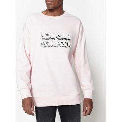 Bluza oversize z okrągłym dekoltem i napisem. Czerwone bluzy męskie rozpinane marki KALENJI, m, z elastanu, z długim rękawem, długie. Za 102,86 zł.