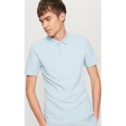 Klasyczna koszulka polo - Niebieski. Niebieskie koszulki polo marki Reserved. Za 39,99 zł.