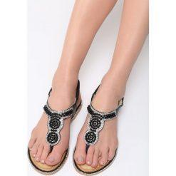 Czarne Sandały International Rescue. Czarne sandały damskie marki Born2be, z materiału, na obcasie. Za 69,99 zł.