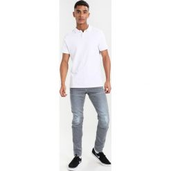 GStar 5620 3D SLIM Jeansy Slim Fit aker stretch denim. Niebieskie jeansy męskie relaxed fit marki G-Star. Za 559,00 zł.