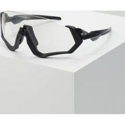 Oakley FLIGHT JACKET Okulary przeciwsłoneczne clear black iridium/photochromic activated. Szare okulary przeciwsłoneczne damskie lenonki marki Oakley. Za 1019,00 zł.
