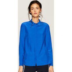 Koszula - Fioletowy. Fioletowe koszule damskie marki DOMYOS, l, z bawełny. W wyprzedaży za 39,99 zł.