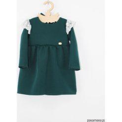 Sukienka butelkowa z koronka. Szare sukienki dziewczęce z falbanami Pakamera, z haftami, z koronki, z długim rękawem, długie. Za 129,00 zł.