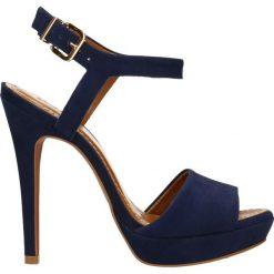 Sandały YAMAYA. Niebieskie sandały damskie Gino Rossi, z nubiku, na wysokim obcasie, na obcasie. Za 249,90 zł.