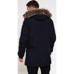 Schott NYC Płaszcz zimowy navy. Niebieskie płaszcze zimowe męskie marki Schott NYC, l, z materiału. Za 1059,00 zł.
