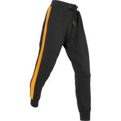 Spodnie dresowe, długie, Level 1 bonprix czarny. Czarne spodnie dresowe damskie marki KIPSTA, l, z bawełny, na fitness i siłownię. Za 99,99 zł.