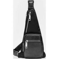 359a950b772ff Torby i plecaki męskie Kazar - Kolekcja wiosna 2019. Czarna torba męska.  Czarne torby męskie na ramię Kazar, w paski, z tkaniny