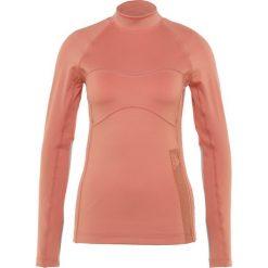 Adidas by Stella McCartney TRAIN  Bluzka z długim rękawem raw pink. Czerwone bluzki sportowe damskie adidas by Stella McCartney, xs, z elastanu, z długim rękawem. Za 379,00 zł.
